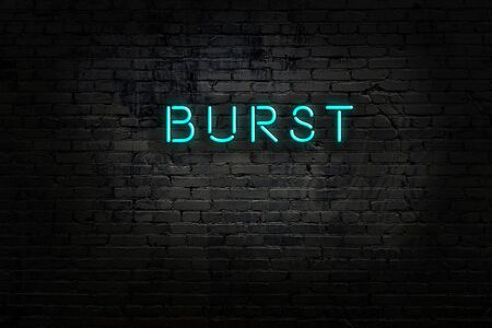 Night view of neon sign on brick wall with inscription burst