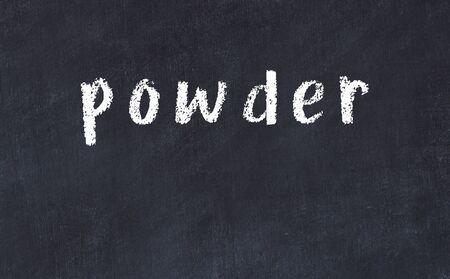 Chalk handwritten inscription powder on black desk