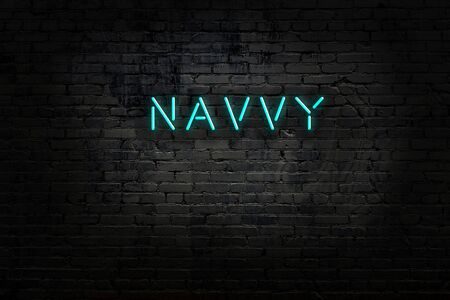 Night view of neon sign on brick wall with inscription navvy