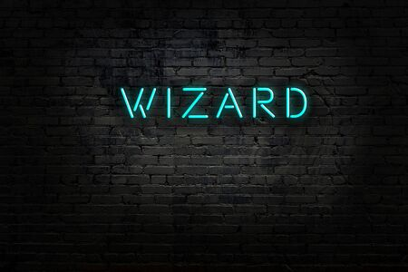 Night view of neon sign on brick wall with inscription wizard