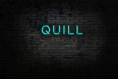 Neon sign with inscription quill against brick wall. Night view