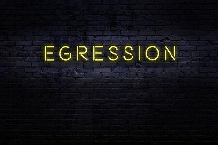Neon sign on brick wall at night. Inscription egression