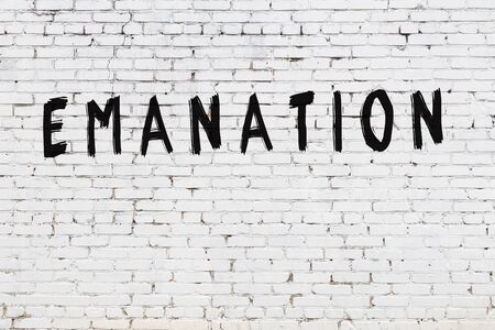 Word emanation written with black paint on white brick wall.