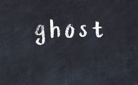 College chalkboard with with handwritten inscription ghost on it Banque d'images