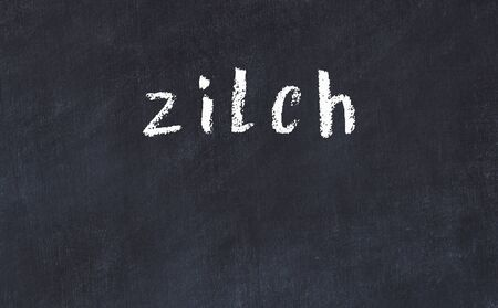 Chalk handwritten inscription zilch on black desk