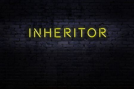 Neon sign on brick wall at night. Inscription inheritor