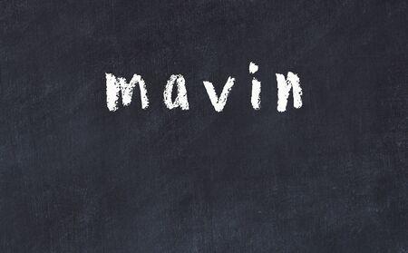 Chalk handwritten inscription mavin on black desk
