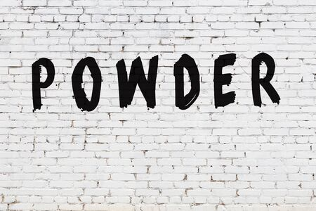 Word powder written with black paint on white brick wall.