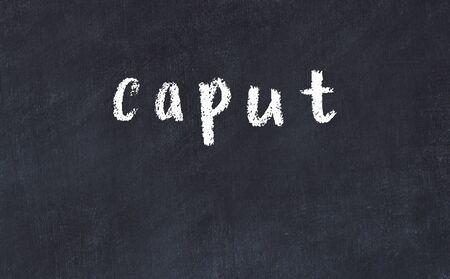 College chalkboard  with with handwritten inscription caput on it 版權商用圖片