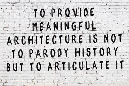 Black painted inscription of smart quotation on white brick wall