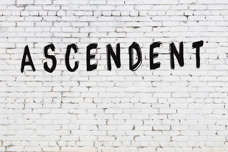 White brick wall with inscription ascendent handwritten with black paint Stok Fotoğraf