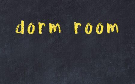 Chalk handwritten inscription dorm room on black desk Stock Photo