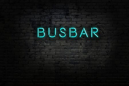 Neon sign with inscription busbar against brick wall. Night view