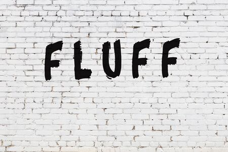 White brick wall with inscription fluff handwritten with black paint Banco de Imagens