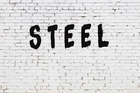 Word steel written with black paint on white brick wall.