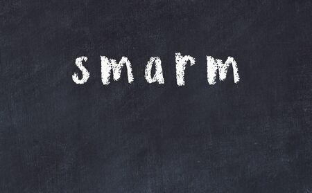 Chalk handwritten inscription smarm on black desk