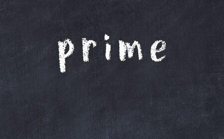 Chalk handwritten inscription prime on black desk