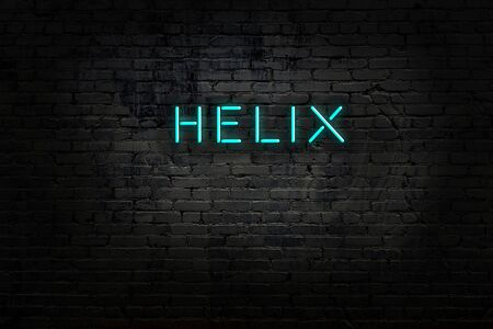 Night view of neon sign on brick wall with inscription helix