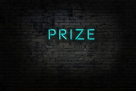 Night view of neon sign on brick wall with inscription prize