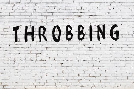 Word throbbing written with black paint on white brick wall.