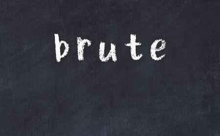 Chalk handwritten inscription brute on black desk