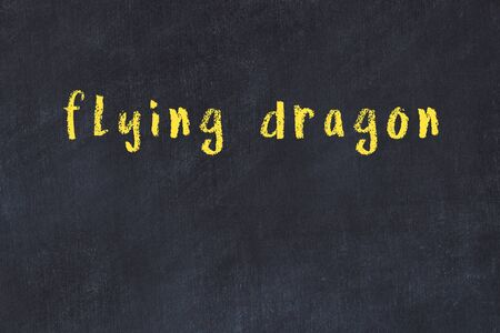 College chalkboard  with with handwritten inscription flying dragon on it
