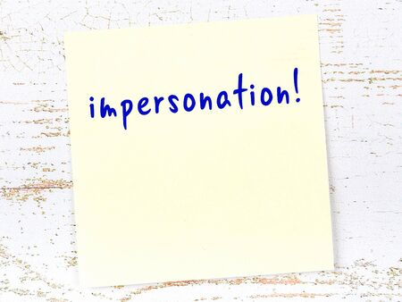 Concept of reminder about impersonation. Yellow sticky sheet of paper on wooden wall with inscription