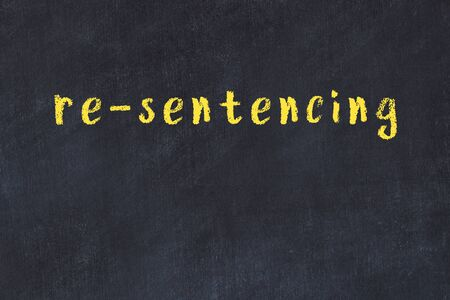 College chalkboard  with with handwritten inscription re-sentencing on it Banco de Imagens