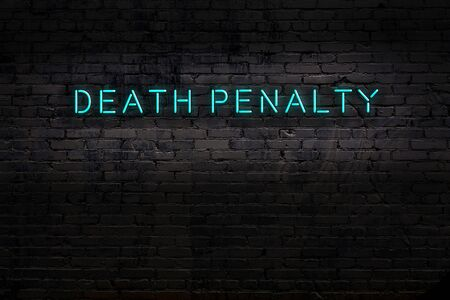 Neon sign on brick wall at night. Inscription death penalty