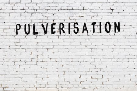 Word pulverisation written with black paint on white brick wall. Imagens