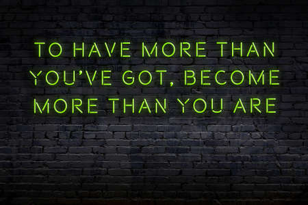 Smart and motivational quotation. Neon sign on brick wall in the darkness