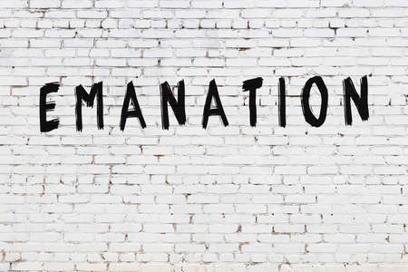 White brick wall with inscription emanation handwritten with black paint