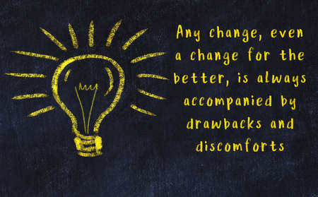 Wise quotation and a chalk drawing of a bulb on black chalkboard Stock fotó