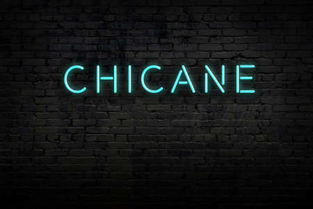 Neon sign on brick wall at night. Inscription chicane