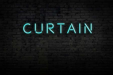 Neon sign on brick wall at night. Inscription curtain