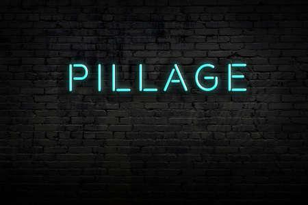 Neon sign on brick wall at night. Inscription pillage