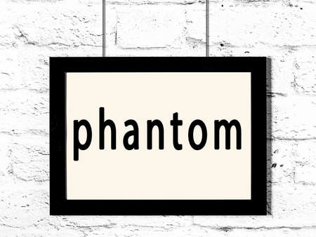 Black wooden frame with inscription phantom hanging on white brick wall Banque d'images