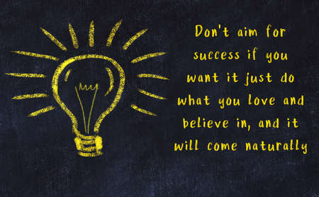 Wise quotation and a chalk drawing of a bulb on black chalkboard