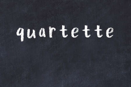 College chalkboard with with handwritten inscription quartette on it
