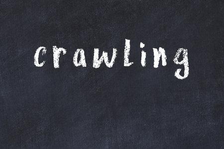 Chalk handwritten inscription crawling on black desk