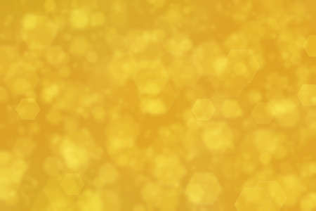 golden abstract defocused background with hexagon shape bokeh spots