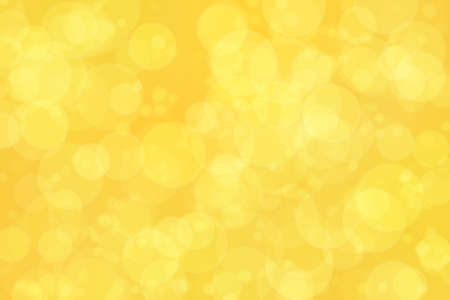 Abstract bokeh background with warm orange and golden colors Stock Photo