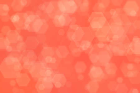 Salmon colored abstract background. Orange red defocused spots.