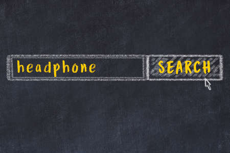 Drawing of search engine on black chalkboard. Concept of looking for headphone Stock fotó