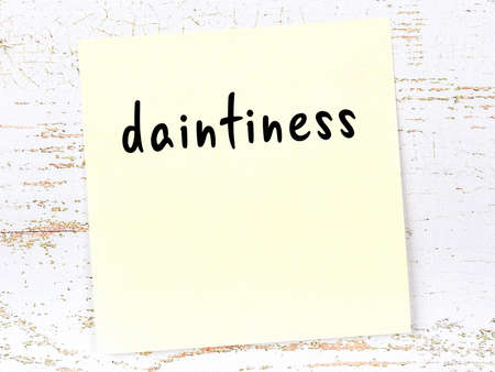 Concept of reminder about daintiness. Yellow sticky sheet of paper on wooden wall with inscription Stock fotó