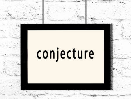 Black wooden frame with inscription conjecture hanging on white brick wall
