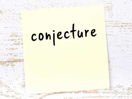 Concept of reminder about conjecture. Yellow sticky sheet of paper on wooden wall with inscription
