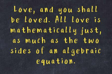 Smart saying handwritten with chalk on black desk