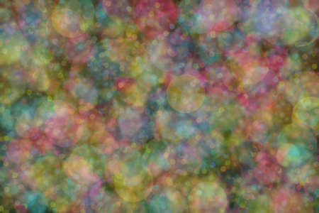Abstract background of multiple colors: blue, pink and yellow and their mixture. Bokeh spots
