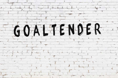 White brick wall with inscription goaltender handwritten with black paint
